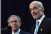 Washington, D.C. - March 3, 2005 -- United States Secretary of Homeland Security Michael Chertoff, right, makes remarks after taking the oath of office at the Ronald Reagan Building in Washington, DC on March 3, 2005. United States President George W. Bush is in background at left.<br /> Credit: Dennis Brack - Pool via CNP