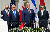 """United States President Donald J. Trump and First lady Melania Trump host a signing ceremony of the """"Abraham Accords"""" on the South Lawn of the White House in Washington, DC on Tuesday, September 15, 2020.  The Trumps are joined by Prime Minister Benjamin Netanyahu of Israel; Sheikh Abdullah bin Zayed bin Sultan Al Nahyan, Minister of Foreign Affairs and International Cooperation of the United Arab Emirates; and Dr. Abdullatif bin Rashid Alzayani, Minister of Foreign Affairs, Kingdom of Bahrain.<br /> Credit: Chris Kleponis / Pool via CNP"""