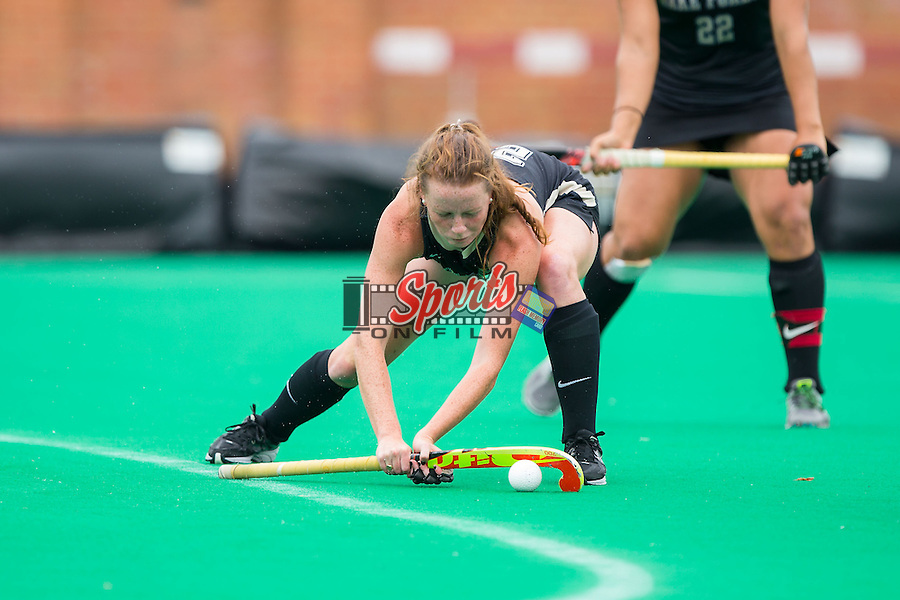 Kali Vicars (25) of the Wake Forest Demon Deacons controls the ball on a penalty corner during second half action against the Duke Blue Devils at Kentner Stadium on September 14, 2014 in Winston-Salem, North Carolina.  The Demon Blue Devils defeated the Demon Deacons 2-1.  (Brian Westerholt/Sports On Film)