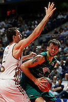 01.04.2012 SPAIN - ACB match played between Real Madrid vs Unicaja  at Palacio de los deportes stadium. The picture show Mirza Begic (Slovenian center of Real Madrid) and Tremmell Darden (Unicaja)