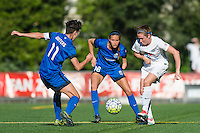 Seattle, WA - Sunday, May 1, 2016: FC Kansas City midfielder Heather O'Reilly (9) passes the ball as Seattle Reign FC defender Carson Pickett (16) looks on during a National Women's Soccer League (NWSL) match at Memorial Stadium. Seattle won 1-0.