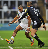 Jonathan Joseph of Bath Rugby puts boot to ball. Aviva Premiership match, between Newcastle Falcons and Bath Rugby on January 2, 2016 at Kingston Park in Newcastle upon Tyne, England. Photo by: Patrick Khachfe / Onside Images