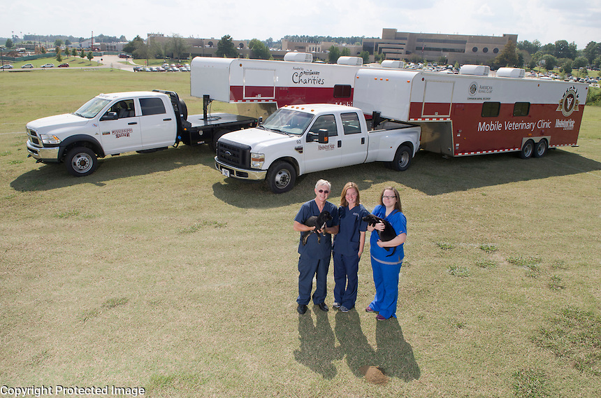 Veterinary Mobile Units with (left to right) Dr. Phil Bushby, Dr. Kimberly Woodruff and Emily Childers.