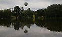 07/06/16<br /> <br /> A balloon is reflected in Allestree Park fishing lake.<br /> <br /> After weeks of rain the Nottingham and Derby Hot Air Balloon Club finally get to launch their three hot air balloons from Allestree Park, Derby.
