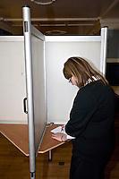 Voter casting her vote at the Polling Station Oxford City Town Hall. .©shoutpictures.com..john@shoutpictures.com