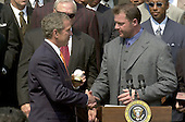 Washington, DC - May 4, 2001 -- U.S. President George W. Bush receives an autographed baseball from Yankee Pitcher Roger Clemens as he welcomed the Major League Baseball 2000 World Champion New York Yankees to the White House.<br /> Credit: Ron Sachs / CNP