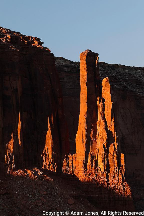 Last sunlight of the day on sandstone pillars, Monument Valley, Monument Valley Tribal Park, Arizona