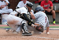 Virginia catcher Robbie Coman (8) collides with Maryland catcher Kevin Martir (32) knocking the ball loose and scoring in the eighth inning of an NCAA college baseball tournament super regional game in Charlottesville, Va., Sunday, June 8, 2014. Virginia defeat Maryland 7-3. (AP Photo/Andrew Shurtleff)