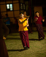 Monks practicing at night - for the masked dance for the Losar ceremony at a monastery in Kalimpong, India