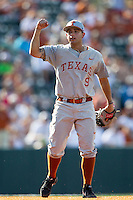 Texas Longhorns shortstop CJ Hinojosa (9) waits for the umpire to make a call at first base during the NCAA baseball game against the Houston Cougars on June 6, 2014 at UFCU Disch–Falk Field in Austin, Texas. The Longhorns defeated the Cougars 4-2 in Game 1 of the NCAA Super Regional. (Andrew Woolley/Four Seam Images)
