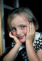 Portrait of smiling little girl with freckles. Little girl. Douglaston NY.