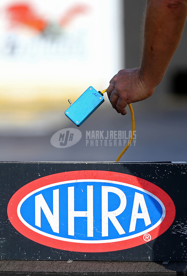 Jun 3, 2016; Epping , NH, USA; Detailed view of the Christmas Tree starting line light system switch in the hand of NHRA official starter Mike Gittings during qualifying for the New England Nationals at New England Dragway. Mandatory Credit: Mark J. Rebilas-USA TODAY Sports