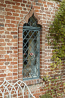An example of one of the 16th-century arabesque-shaped lead-paned windows
