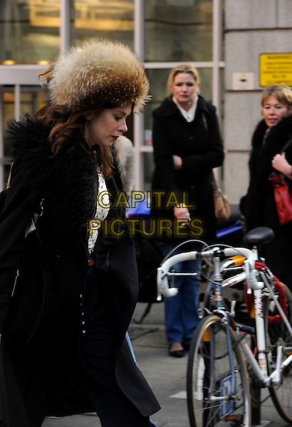 Anna Friel spotted in central London, England..17th January, 2012 [ Exclusive ].** Exclusive All-Rounder**.half length black coat fur hat white polka profile dot top trousers cigarette smoking brown.CAP/IA.©Ian Allis/Capital Pictures.