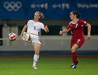 Rhian Wilkinson, Lindsay Tarpley. The USWNT defeated Canada in extra time, 2-1, during the 2008 Beijing Olympics in Shanghai, China.