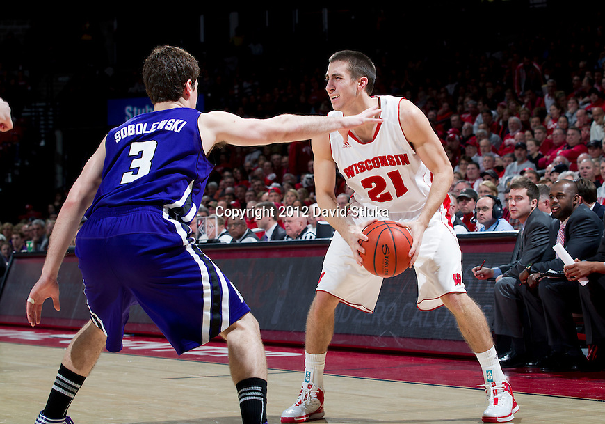 Northwestern Wildcats guard Dave Sobolewski (3) defends against Wisconsin Badgers guard Josh Gasser (21) during a Big Ten Conference NCAA college basketball game on January 18, 2012 in Madison, Wisconsin. The Badgers won 77-57. (Photo by David Stluka)