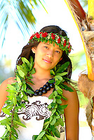 Young woman with maile leaf and kukui nut lei