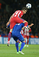 Atletico Madrid's Jose Gimenez climbs over the back of Leicester City's Leonardo Ulloa<br /> <br /> Photographer Stephen White/CameraSport<br /> <br /> UEFA Champions League Quarter Final Second Leg - Leicester City v Atletico Madrid - Tuesday 18th April 2017 - King Power Stadium - Leicester <br />  <br /> World Copyright &copy; 2017 CameraSport. All rights reserved. 43 Linden Ave. Countesthorpe. Leicester. England. LE8 5PG - Tel: +44 (0) 116 277 4147 - admin@camerasport.com - www.camerasport.com