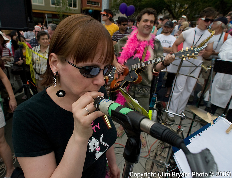 Kiki Hood plays a kazoo with the Fremont Philharmonic Band at the 21st Annual Fremont Summer Solstice Parade in Seattle on June 20, 2098. The parade was held Saturday, bringing out painted and naked bicyclists, bands, belly dancers and floats. (Jim Bryant Photo © 2009)