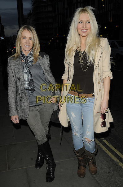 KAREN MILLEN & EMMA NOBLE.'Recognise' magazine Launch Party at Swarovski Crystallized, London, England. .April 13th, 2010 .full length jeans denim brown biker boots beige coat jacket top grey gray tweed.CAP/CAN.©Can Nguyen/Capital Pictures.