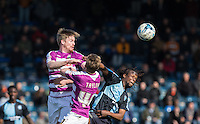 Michael Gash of Barnet beats Marcus Bean of Wycombe Wanderers to the ball during the Sky Bet League 2 match between Wycombe Wanderers and Barnet at Adams Park, High Wycombe, England on 16 April 2016. Photo by Andy Rowland.