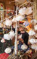 BNPS.co.uk (01202 558833)<br /> Pic: PhilYeomans/BNPS<br /> <br /> Fairy Grandmother - Bespoke fairy maker Dinah Nicholson gets a helping hand from grandchildren Franka, Carla and Daisy this Christmas...<br /> <br /> Described as a 'Living National Treasure' by Country Life magazine her unique creations have even been supplied as wedding gifts for the bridesmaids at Royal weddings.<br /> <br /> Each of her 4159 creations so far have been logged in a fairy ledger, and the £60 cost has never been increased as 'I want everyone to be able to afford one'.