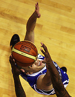 Heat import Mike Bell steals the ball from Lindsay Tait during the National Basketball League match Wellington Saints and Harbour Heat at TSB Bank Arena, Wellington, New Zealand on Saturday 13 June 2009. Photo: Dave Lintott / lintottphoto.co.nz
