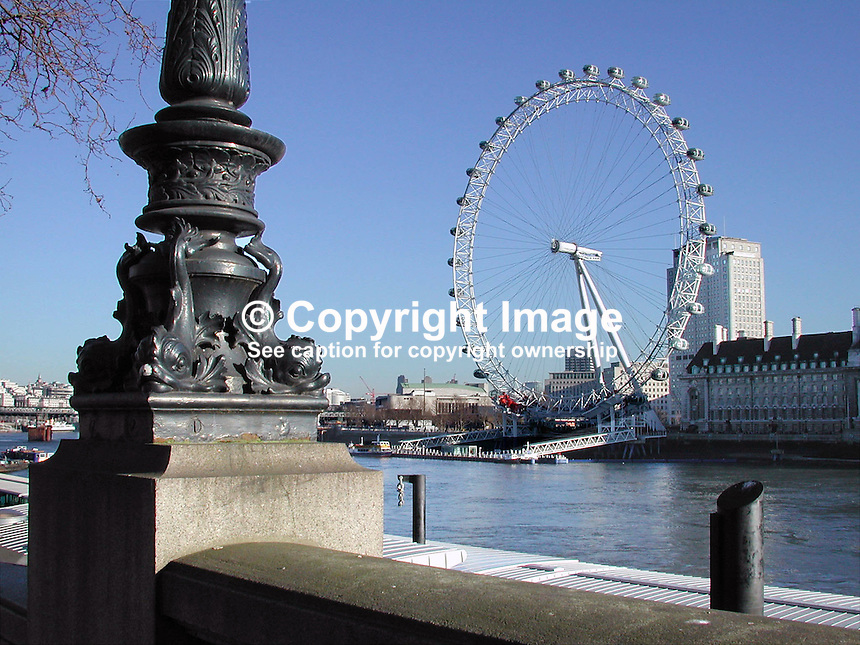 The London Eye, aka Millenium Wheel, sponsored by British Airways, dwarfs the London skyline. Photographed from across the River Thames near Wesminster Bridge. Ref: 2001011555..Copyright Image from Victor Patterson, 54 Dorchester Park, Belfast, UK, BT9 6RJ..Tel: +44 28 9066 1296.Mob: +44 7802 353836.Voicemail +44 20 8816 7153.Skype: victorpattersonbelfast.Email: victorpatterson@mac.com.Email: victorpatterson@ireland.com (back-up)..IMPORTANT: If you wish to use this image or any other of my images please go to www.victorpatterson.com and click on the Terms & Conditions. Then contact me by email or phone with the reference number(s) of the image(s) concerned.
