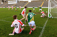 XXJOB 18-11-2015:  Colin O'Muircheartaigh, Pobalscoil Scoil Chorca Dhuibhne tackles  Patrick Darcy who shoots for goal for St. Brendan's College, Killarney at the Munster u-15 footbal final in Killarney on wednesday.<br /> Picture by Don MacMonagle
