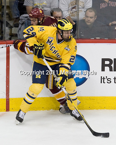 Jack Connolly (Duluth - 12), Jon Merrill (Michigan - 24) - The University of Minnesota-Duluth Bulldogs defeated the University of Michigan Wolverines 3-2 (OT) to win the 2011 D1 National Championship on Saturday, April 9, 2011, at the Xcel Energy Center in St. Paul, Minnesota.