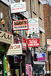 Signs travel agents, mini cabs, food, Brick Lane London
