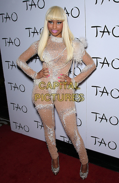 NICKI MINAJ .Grammy nominee Nicki Minaj celebrates her birthday at TAO Las Vegas inside the Venetian Resort Hotel and Casino,  Las Vegas, Nevada, USA, .9th December 2010..full length white beige nude body stocking catsuit pantsuit jumpsuit beaded pearls embellished hands on hips silver glittery shoes wig  .CAP/ADM/MJT.© MJT/AdMedia/Capital Pictures.