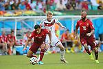 (L to R) <br /> Ricardo Costa (POR), <br /> Andre Schurrle (GER), <br /> Raul Meireles (POR), <br /> JUNE 16, 2014 - Football /Soccer : <br /> 2014 FIFA World Cup Brazil <br /> Group Match -Group G- <br /> between  Germany 4-0 Portugal <br /> at Arena Fonte Nova, Salvador, Brazil. <br /> (Photo by YUTAKA/AFLO SPORT)