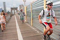 Brooklyn, NY -  3 September 2010 The Can Man, an environmental activists, joined unicyclists riding across the Brooklyn Bridge on their 13 mile journey to Coney Island. The Brooklyn Long Distance Unicycle Ride marked the first of a three day celebration of one wheeled human powered transportation.