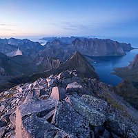 Twilight light over mountain landscape from rocky summit of Hermannsdalstinden, Moskenesoy, Lofoten Islands, Norway