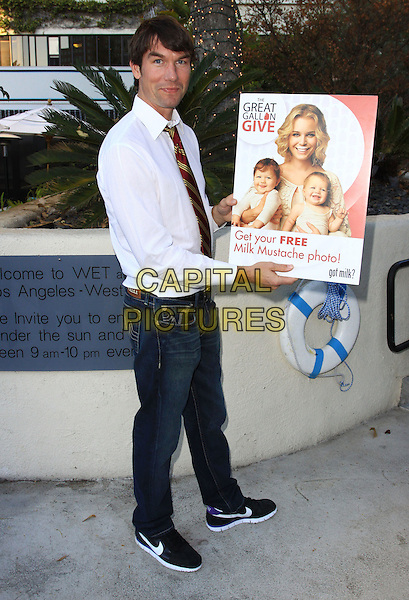 "JERRY O'CONNELL.Rebecca Romijn launches the National Milk Mustache ""got milk?"" held At The W Hotel, Westwood, California, USA..January 11th, 2009.full length white shirt red tie jeans denim poster.CAP/ADM/KB.©Kevan Brooks/AdMedia/Capital Pictures."