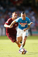 Calcio, Serie A: Napoli vs Roma. Napoli, stadio San Paolo, 15 ottobre. <br /> Napoli's Marek Hamsik, right, is chased by Roma&rsquo;s Daniele De Rossi during the Italian Serie A football match between Napoli and Roma at Naples' San Paolo stadium, 15 October 2016. Roma won 3-1.<br /> UPDATE IMAGES PRESS/Isabella Bonotto