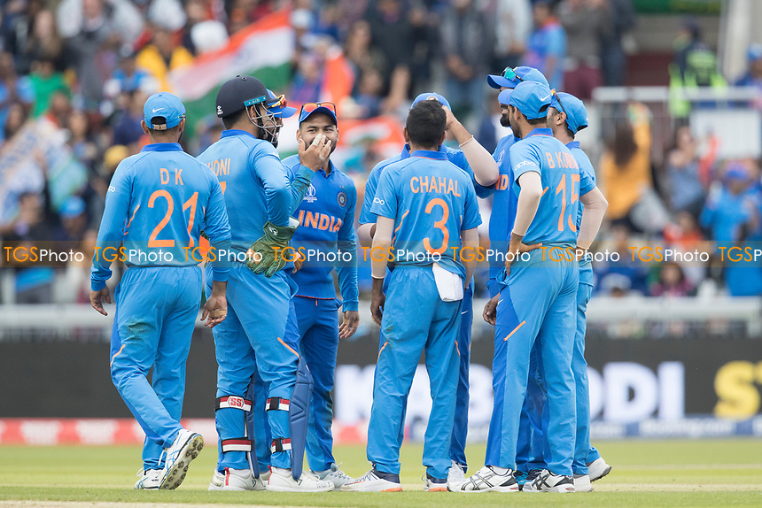 The insane players get together after the crucial wicket of Williamson during India vs New Zealand, ICC World Cup Semi-Final Cricket at Old Trafford on 9th July 2019