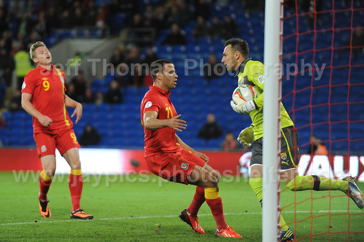 Cardiff City Stadium, Friday 11th Oct 2013. Hal Robson-Kanu of Wales challenges Tome Pacovski the Macedonia goalkeeper during the Wales v Macedonia FIFA World Cup 2014 Qualifier match at Cardiff City Stadium, Cardiff, Friday 11th Oct 2014. All images are the copyright of Jeff Thomas Photography-07837 386244-www.jaypics.photoshelter.com