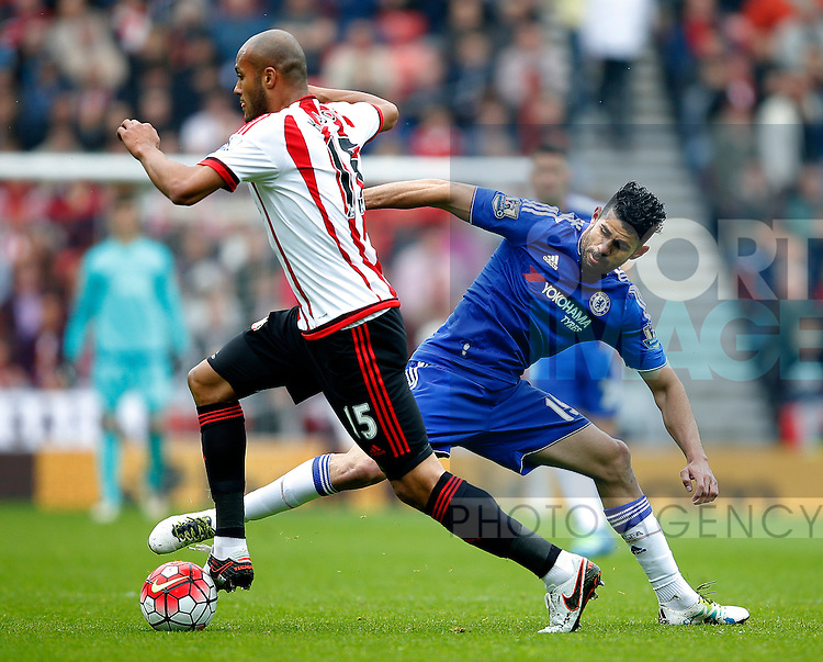 Younes Kabul of Sunderland challenged by Diego Costa of Chelsea during the Barclays Premier League match at the Stadium of Light, Sunderland. Photo credit should read: Simon Bellis/Sportimage