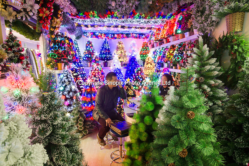 November 27, 2015, Yiwu China - A stall featuring Christmas trees in the Festival Arts section of Arts of Crafts inside the Yiwu International Trade Market. Yiwu International Trade Market is the world's largest whole sale market for small commodities. These plastic trees are made locally at the Sinte An factory.Photo by Dave Tacon / Sinopix