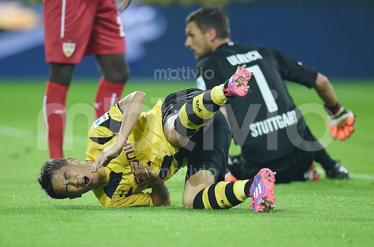 Fussball  1. Bundesliga  Saison 2014/2015   5. SPIELTAG Borussia Dortmund - VfB Stuttgart     24.09.2014 Shinji Kagawa (Borussia Dortmund) liegt verletzt am Boden.