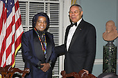 Musician James Brown, left, one of the 2003 Kennedy Center honorees, talking with United States Secretary of State Colin Powell after a dinner in his honor at the United States Department of State in Washington, DC on December 6, 2003..