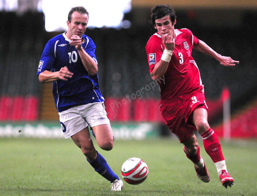 Gareth Bale on the attack with Branimir Subasic in pursuit. Wales v Azerbaijan.Group 4, 2010 World Cup Qualifier. © Ian Cook IJC Photography iancook@ijcphotography.co.uk www.ijcphotography.co.uk