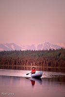 Woman canoeing, sunset, Kenai NWR, Alaska