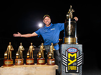 Nov 11, 2018; Pomona, CA, USA; NHRA photographer Marc Gewertz poses for a portrait with the championship trophy during the Auto Club Finals at Auto Club Raceway. Mandatory Credit: Mark J. Rebilas-USA TODAY Sports