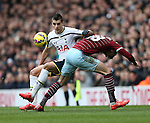 Tottenham's Erik Lamela tussles with West Ham's Carl Jenkinson<br /> <br /> Barclays Premier League - Tottenham Hotspur  vs West Ham  - White Hart Lane - England - 22nd February 2015 - Picture David Klein/Sportimage