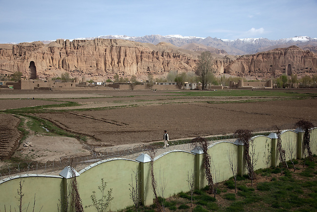 08 May 2012, Bamiyan, Afghanistan :   The empty niches that once contained the largest free standing statues of Buddha that dominate the skyline of Bamiyan city. The Taliban destroyed the statues by blowing them up in March 2001 . Picture by Graham Crouch/World Bank