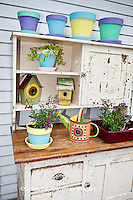 63821-202.18 Potting bench with containers, birdhouses and flowers in spring, Marion Co. IL