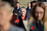 Pictured: A woman observes the minute's silence Friday 11 November 2016<br /> Re: Remembrance Day service at Castle Square Gardens in Swansea, south Wales, UK.